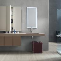 META Una soluzione minimal per un bagno dalle superfici continue